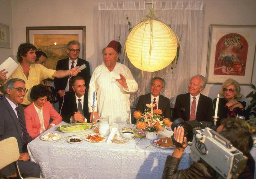 Legendary Jerusalem mayor Teddy Kollek hosts a post-Passover Mimouna celebration in his home, togeth