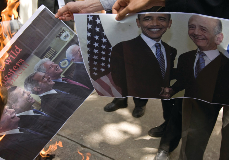 STUDENTS BURN a picture of former American presidents, along with another featuring Olmert (right) i