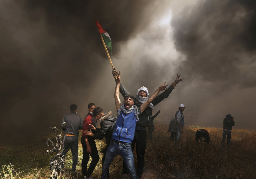 Israeli fire in Gaza border protest kills 4 Palestinians