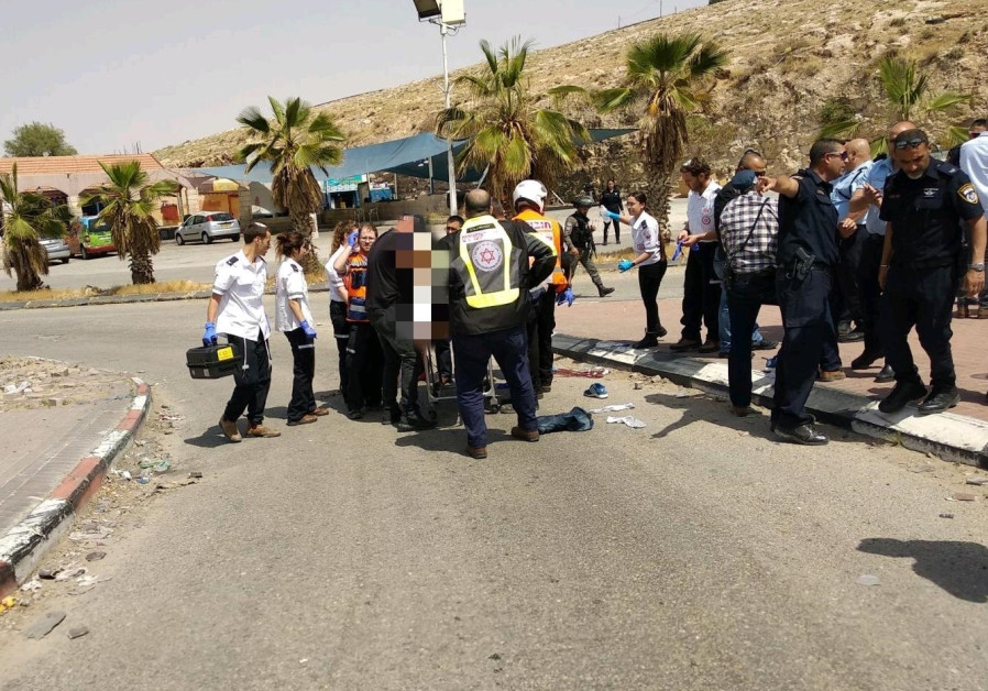 MDA paramedics escort the body of a Palestinian who was shot by an Israeli after an attempted stabbing (Magen David Adom)
