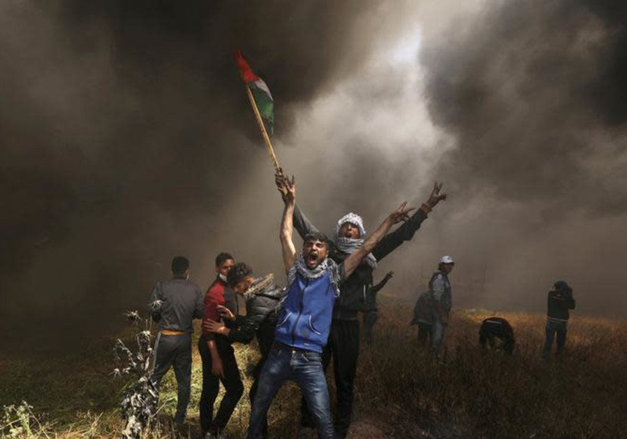 Palestinians demonstrators shout during clashes with Israeli troops.
