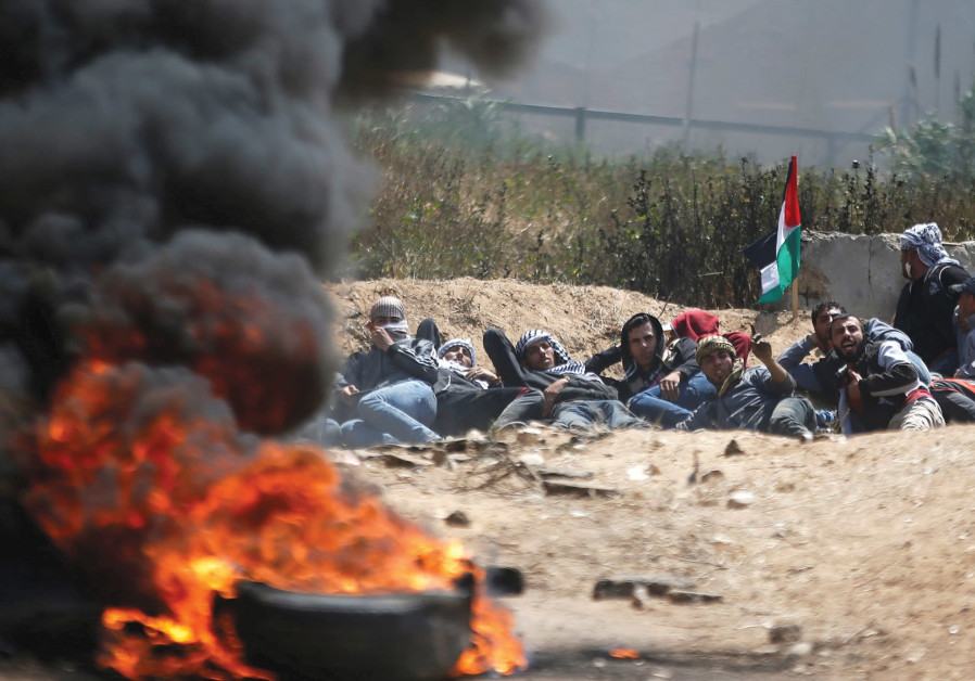 PALESTINIANS ATTEND a massive protest in Gaza on Friday.