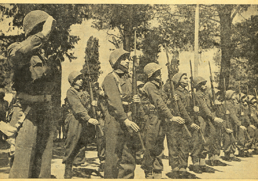 On February 14, 1949, the honor guard of the IDF stands ready to salute David Ben-Gurion, as the Kn