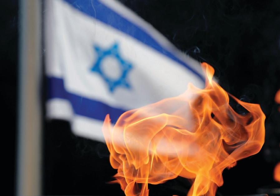 A TORCH burns on Jerusalem's Mount Herzl, 2017