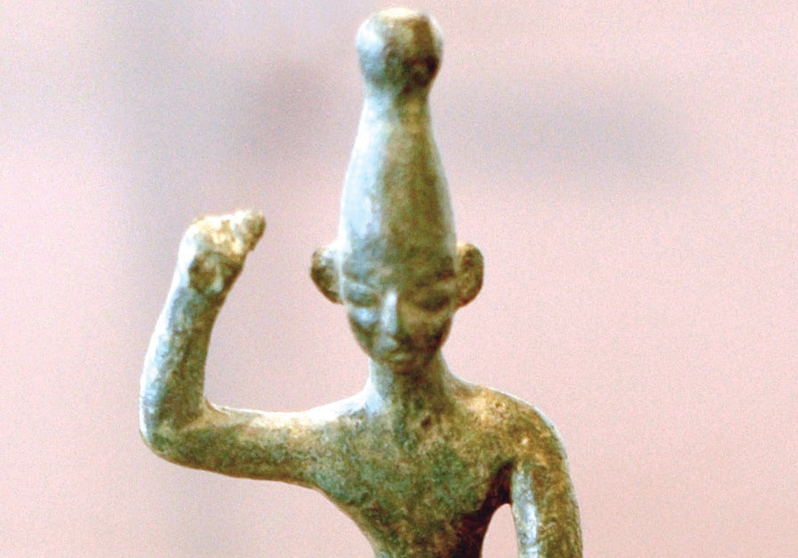 AN ANCIENT Canaanite idol of Baal with raised arm from the 14th–12th centuries BCE, found at Ras Sha