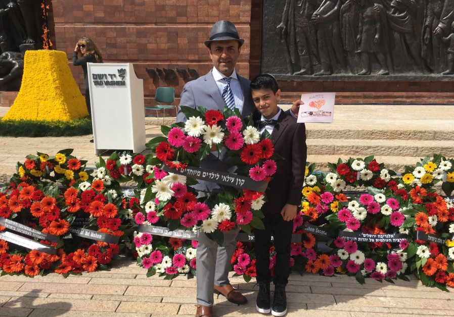 Albert Shaltiel and his son Ilai at the Holocaust Day wreath laying