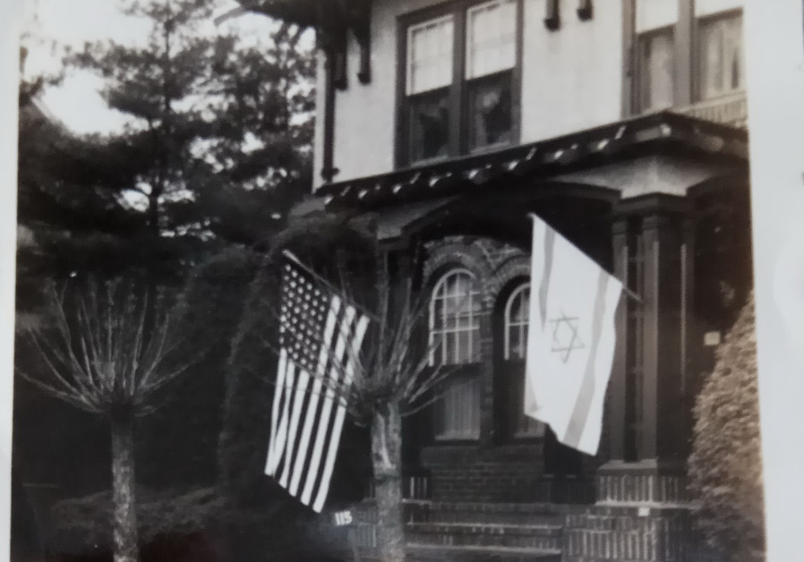 Thelma Jacobsn's childhood home, with Israeli and American flags flying out front
