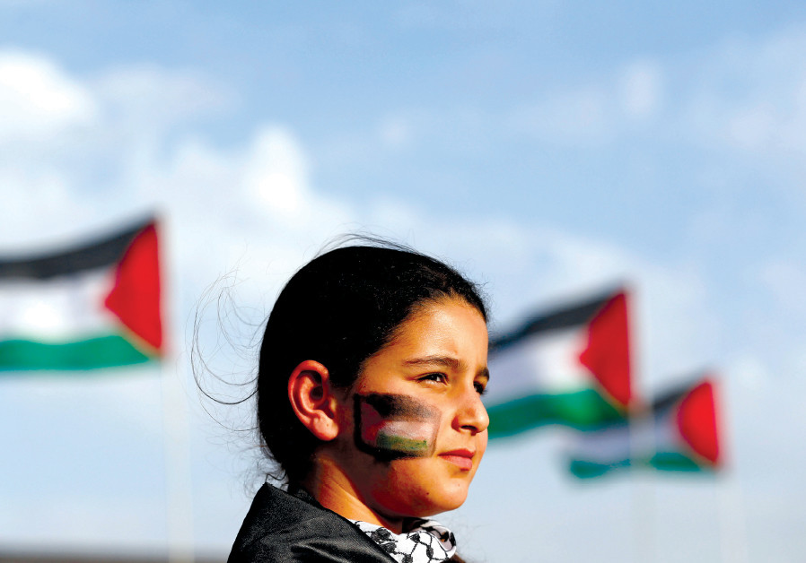AN ISRAELI Arab girl takes part in a 'Land Day' rally, an annual commemoration of the killing of six