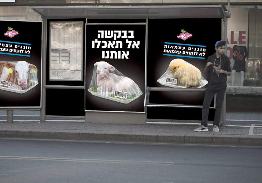 "A billboard from the NGO Vegan Friendly says, ""Please don't eat us"""