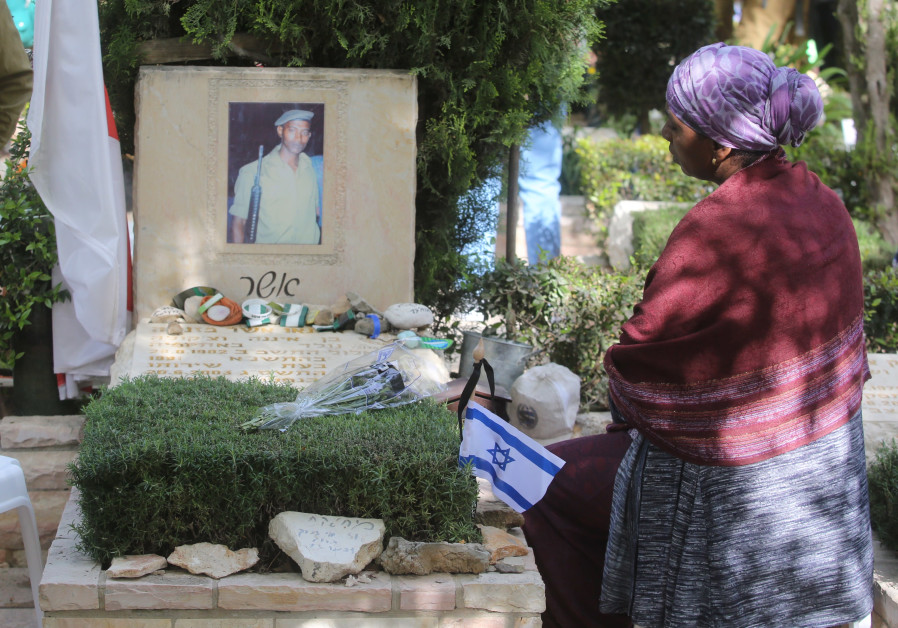 An Israeli visits the grave of a fallen soldier on Mount Herzl during Remembrance Day on April 18th
