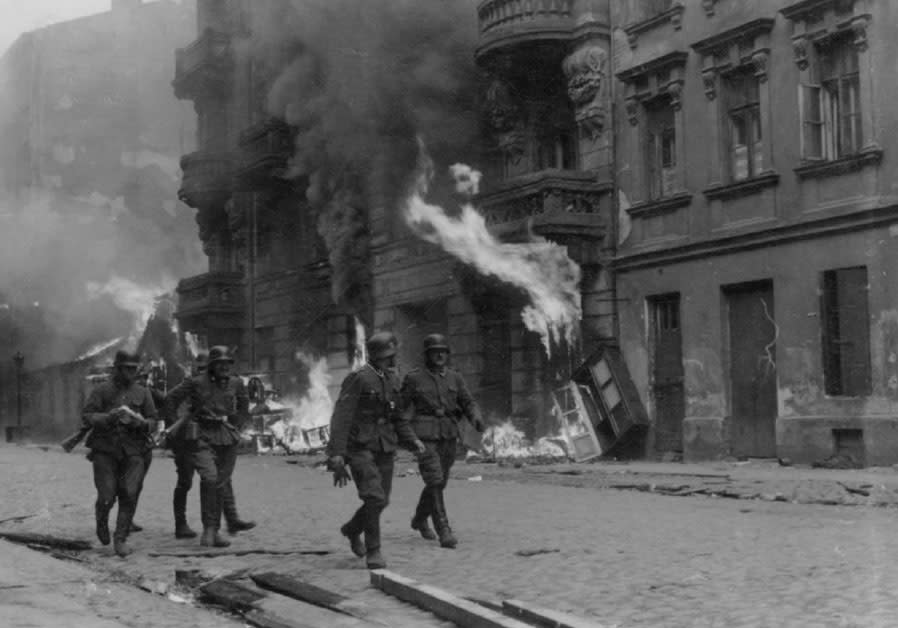 SS SOLDIERS patrol Nowolipie Street in the Warsaw Ghetto during the 1943 uprising