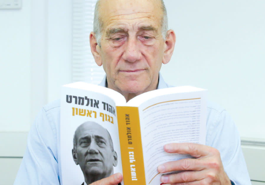 FORMER prime minister Ehud Olmert reads his new book