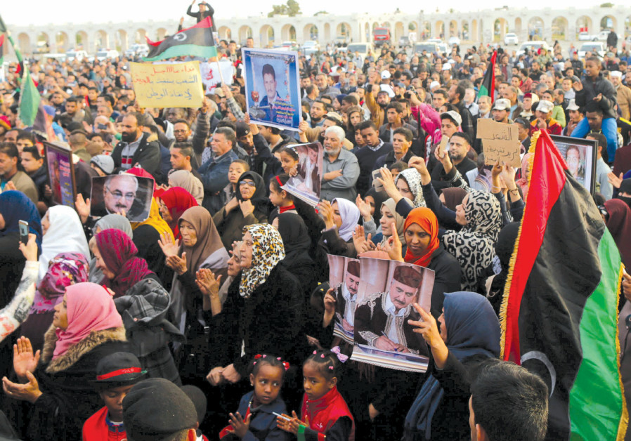 SUPPORTERS OF Eastern Libyan military commander Khalifa Haftar take part in a rally in Benghazi, Lib