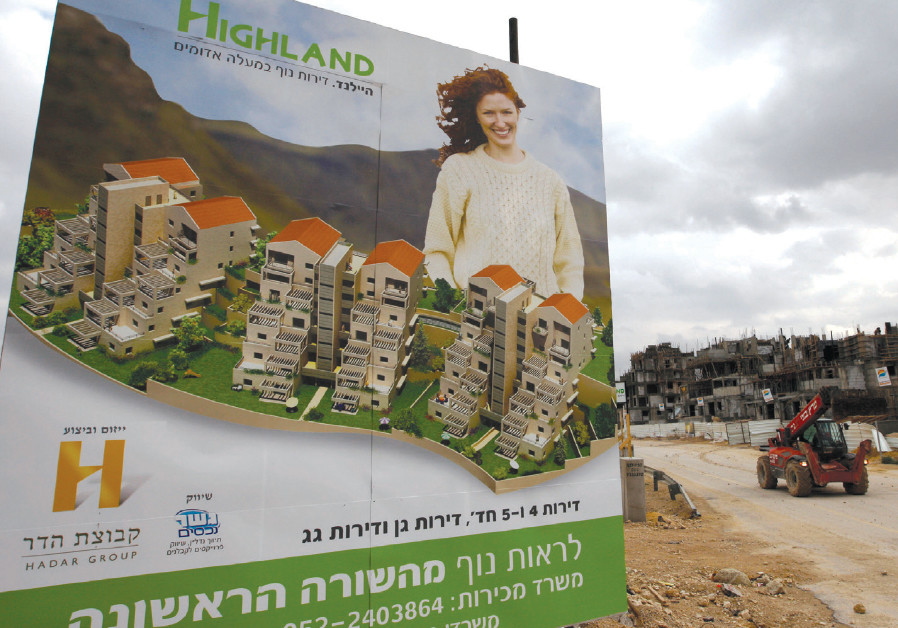 A BILLBOARD advertises new apartments for sale at a construction site in Ma'aleh Adumim in 2009