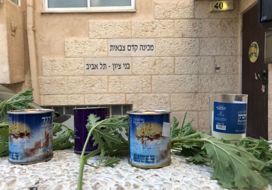 Memorial candles set out in front of the pre-millitary Bnei Zion Academy in Tel Aviv.