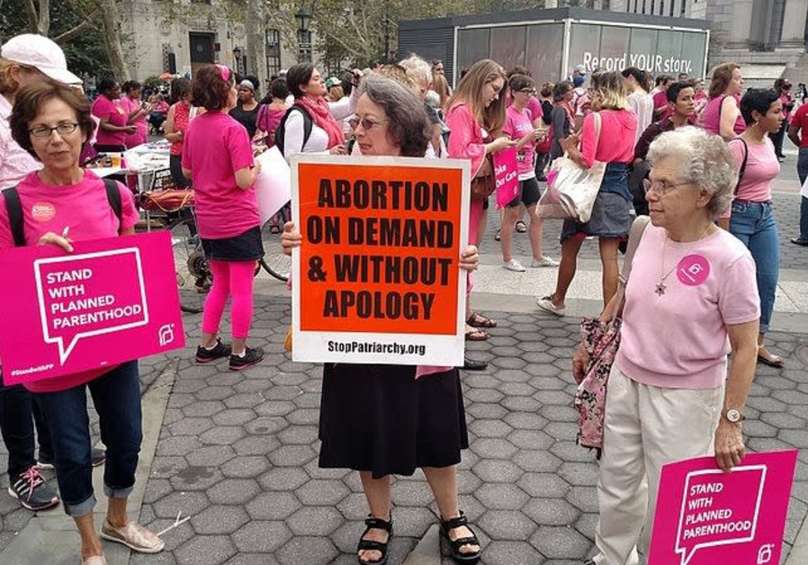 Planned Parenthood supporters and one anti-choice activist at a rally in New York