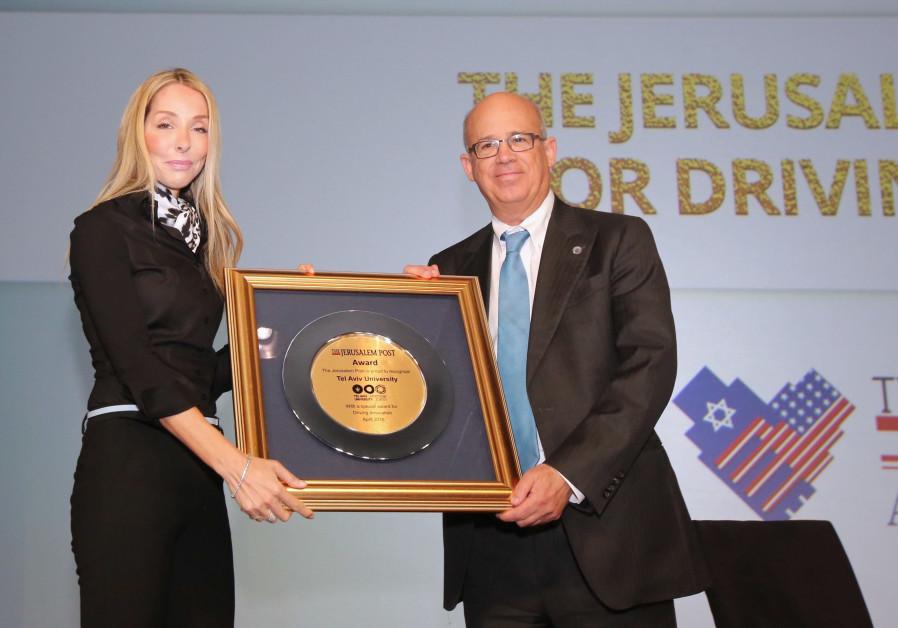 Jerusalem Post Group CEO Ronit Hasin-Hochman presenting award for Inspiring Innovation to Tel Aviv U
