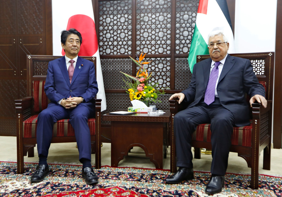 Palestinian President Mahmoud Abbas meets with Japan's Prime Minister Shinzo Abe in Ramallah