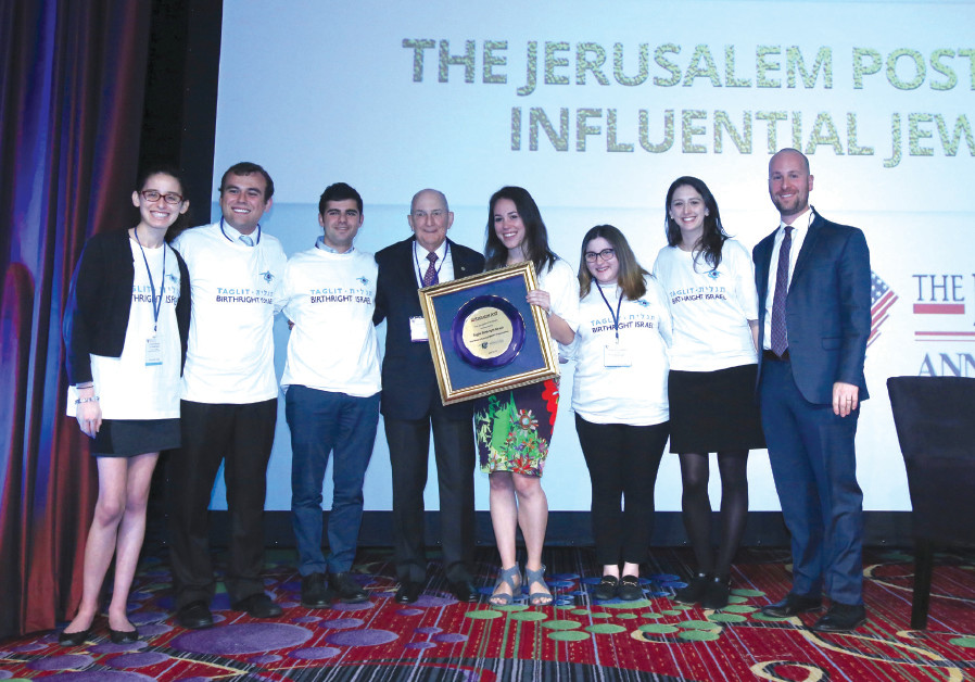 CHARLES BRONFMAN appears on stage with 'Jerusalem Post' Editor-in-Chief Yaakov Katz (far right) and
