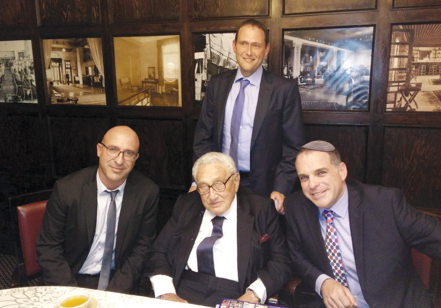 ODED REVIVI PAUSES for a photo during a meeting with former US secretary of state Henry Kissinger an