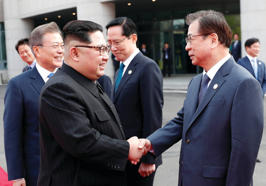 NORTH KOREAN leader Kim Jong-un shakes hands with Suh Hoon, South Korea's chief of the National Inte