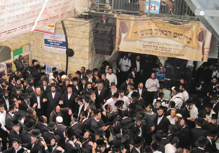 WORSHIPERS GATHER at the tomb of Rabbi Shimon Bar Yohai on Lag Ba'omer in 2016 in Meron