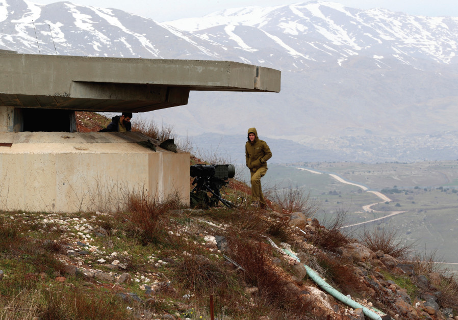 AN ISRAELI soldier stands next to the Golan border with Syria. Iran's encroachments into Syria has l