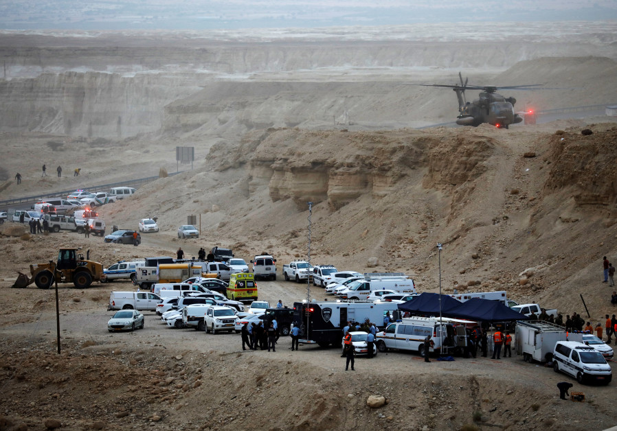 Israeli rescue services operate near the site where a group of Israeli youths was swept away