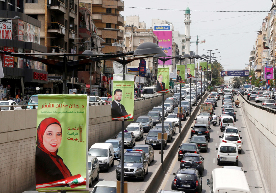 Campaign posters of Lebanese parliament candidates are seen in Beirut, Lebanon May 2, 2018