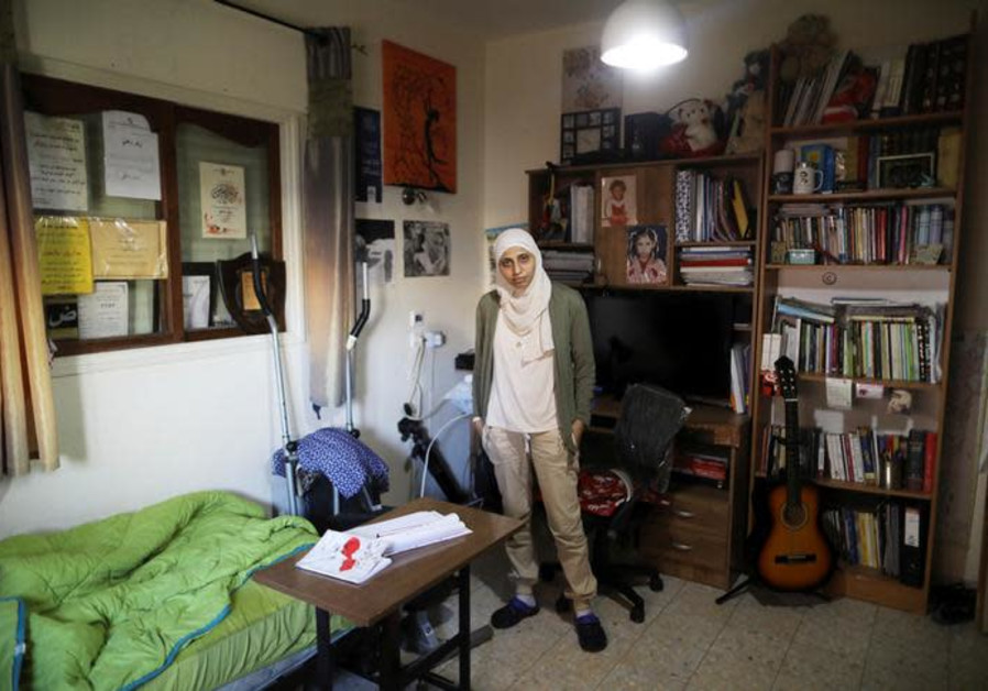 Arab-Israeli poet Dareen Tatour poses for a picture.