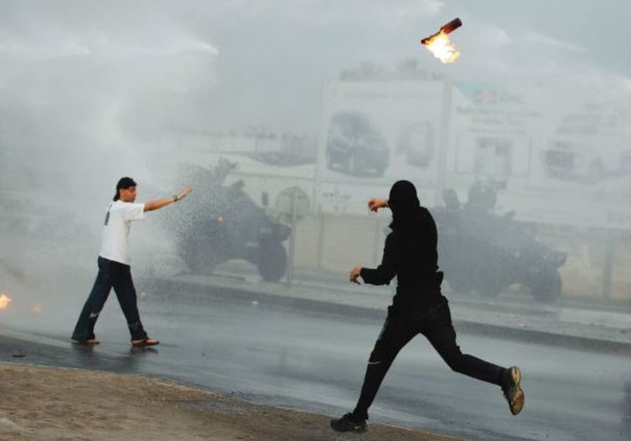 PROTESTERS CLASH with police in Bahrain during 2011 Arab Spring protests