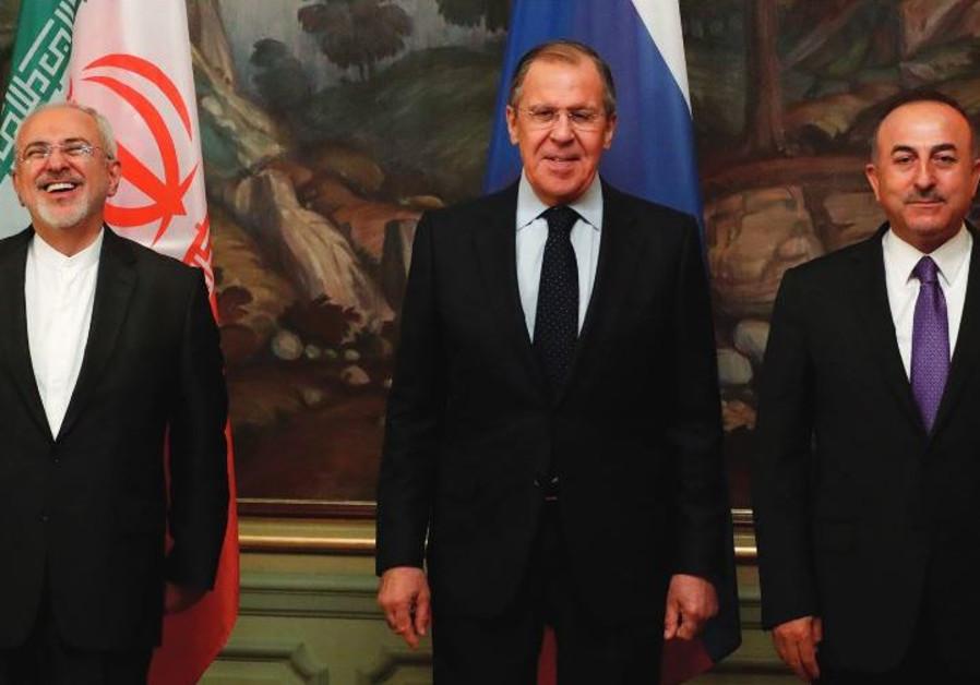 Ministers Mohammad Javad Zarif of Iran, Sergei Lavrov of Russia and Mevlut Cavusoglu of Turkey
