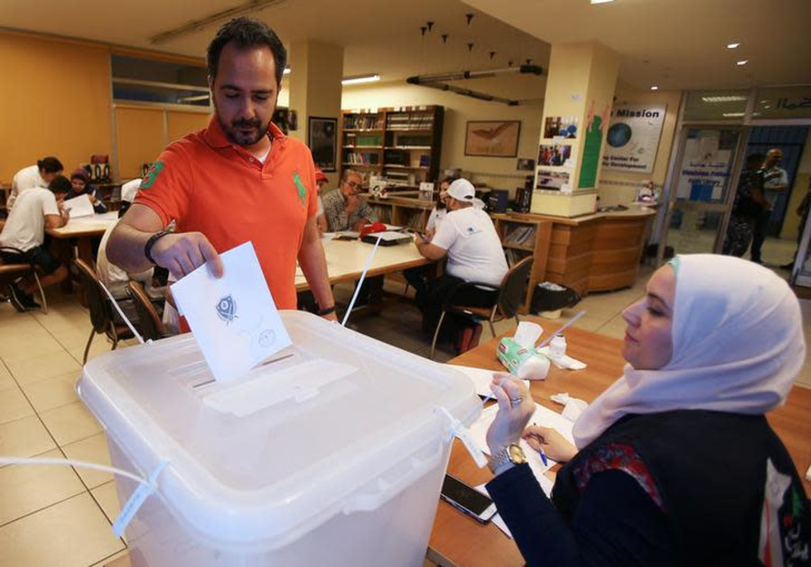 A man casts his vote at a polling station during the parliamentary election, in Sidon, Lebanon.