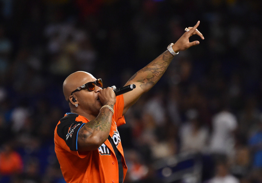 Recording artist Flo Rida performs before the MLB legends and celebrity softball game at Marlins Par