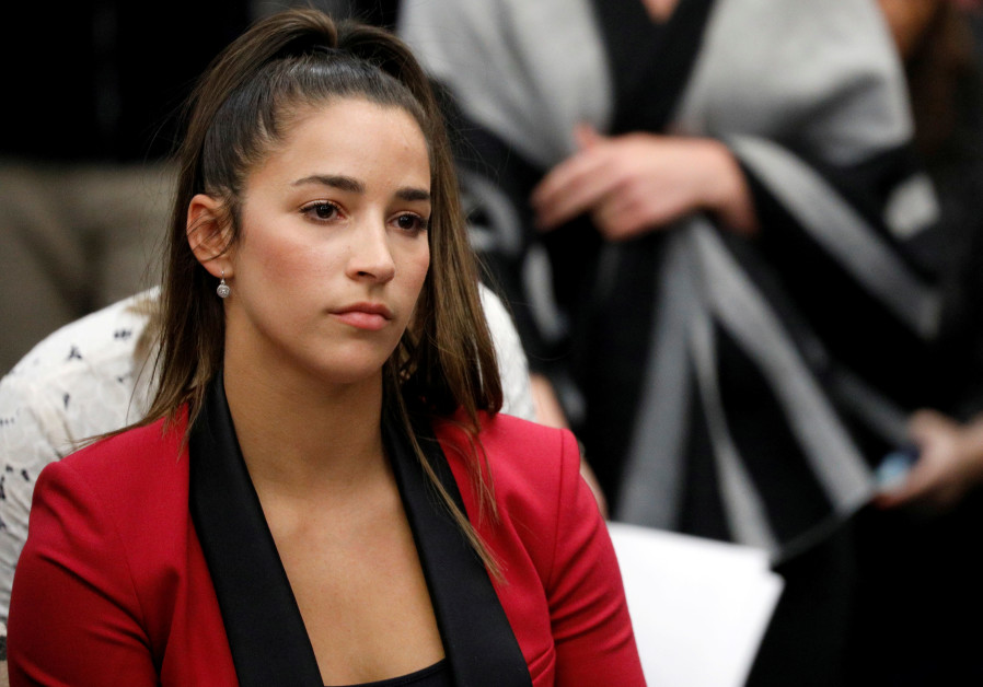Victim and Olympic gold medalist Aly Raisman appears at the sentencing hearing for Larry Nassar