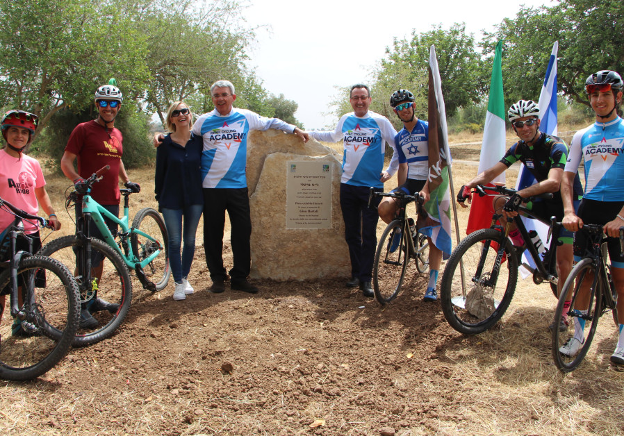 The Israeli Cycling Academy team, granddaughter Gioia Bartali, Italian Ambassador Gianluigi Benedett