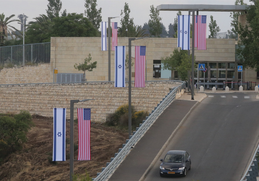 Side-by-side Israeli and American flags line the road down from the US Consulate General in the Arno