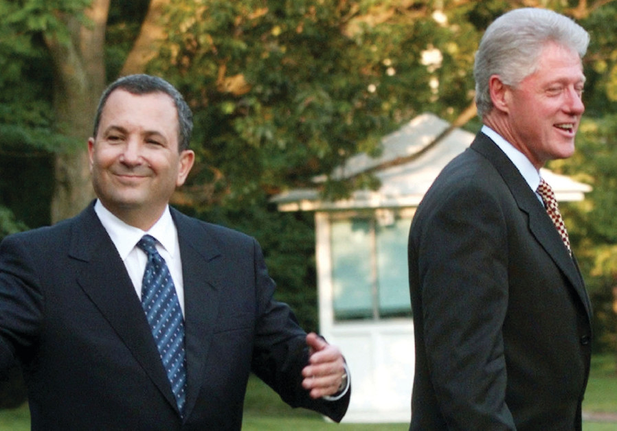 THEN-PRIME MINISTER Ehud Barak gestures as he and US president Bill Clinton depart the White House e