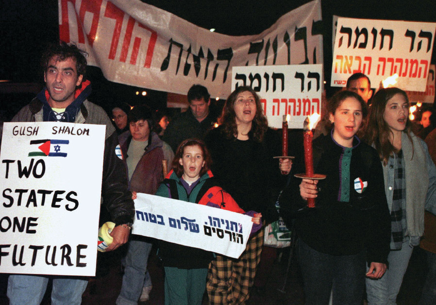 HUNDREDS OF Israeli peace activists demonstrate in 1997 against the decision by the government to bu
