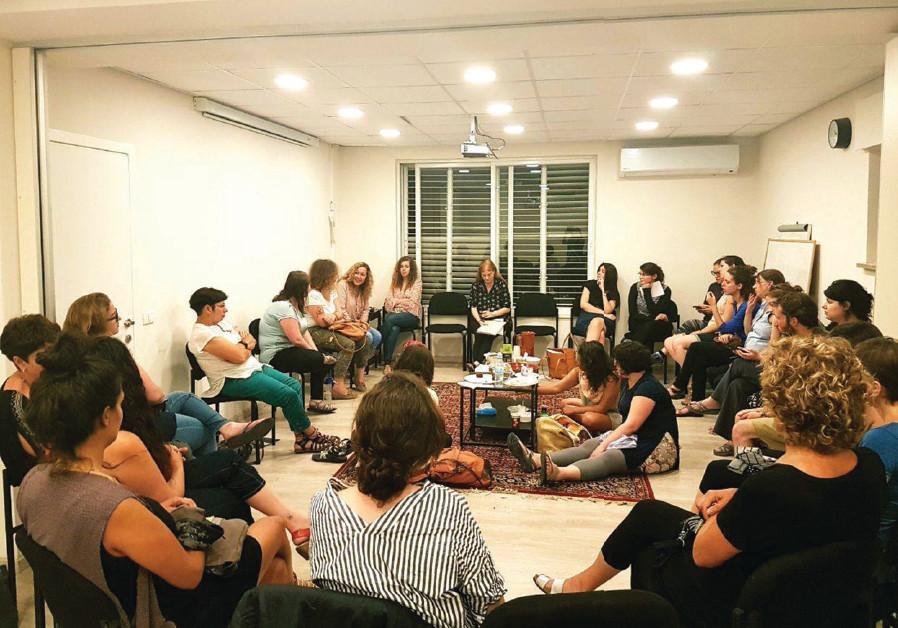 Volunteers meet at the Jerusalem Rape Crisis Center