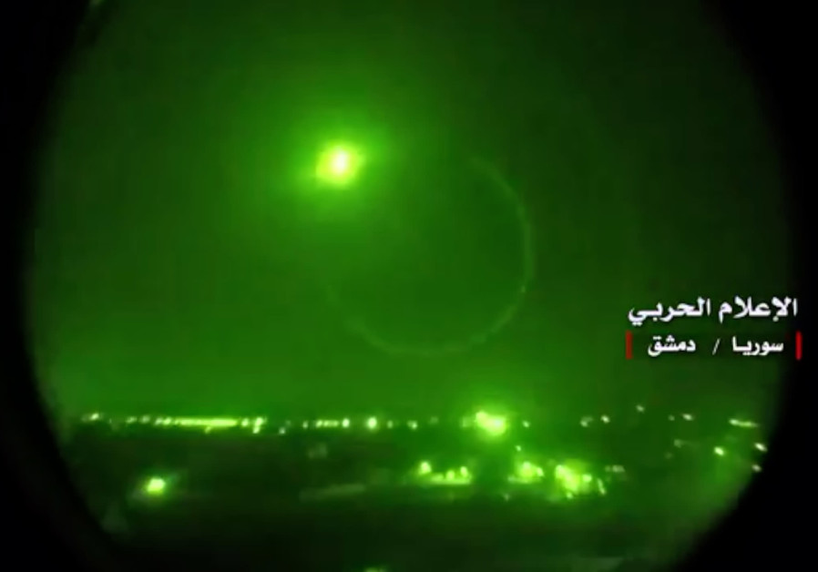 An image grab from a videopurportedly shows Syrian air defense systems intercepting Israeli missiles