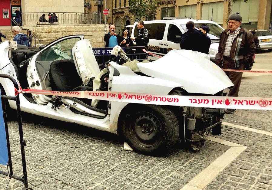 A CAR wreck exhibition surrounded by police tape in Jerusalem's Zion Square last week