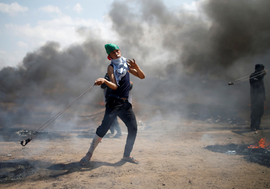 Unprecedented' violence in Gaza leaves 58 Palestinians dead thousands wounded