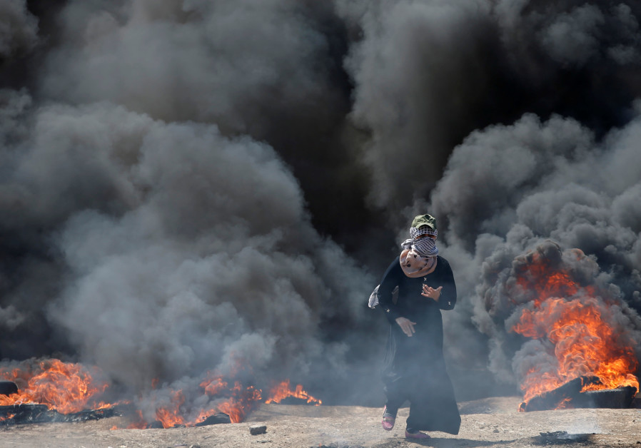 A female Palestinian demonstrator during a protest in Gaza against US embassy move to Jerusalem