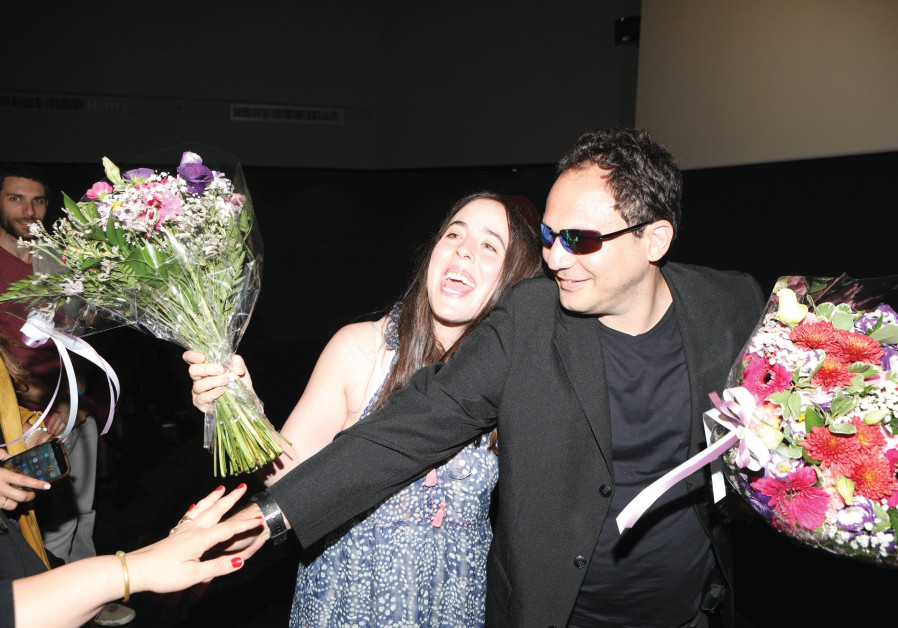 BRANDON POLANSKY and Samantha Elisofon goof around during their visit to Israel to promote the movie