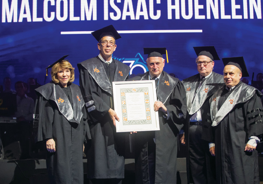 Malcolm Hoenlein (center) receives his honorary doctorate from Bar-Ilan University  flanked by (from