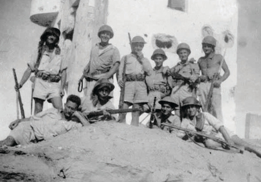 Negev Brigade and Kibbutz Dorot members resting after a May 15, 1948 battle