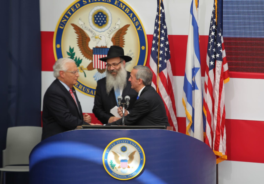 Pastor Robert Jeffress and Rabbi Rabbi Zalman Wolowik share the stage with U.S. Ambassador David Fri
