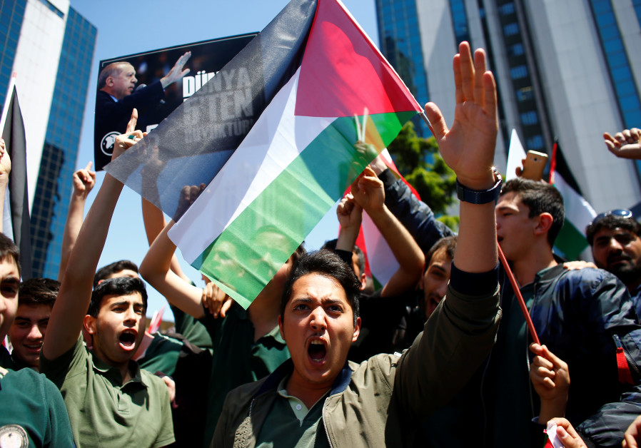 A pro-Palestinian demonstrator shouts during a protest against the U.S. embassy move to Jerusalem