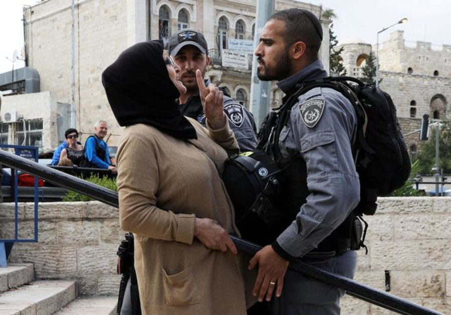 DATE IMPORTED: May 14, 2018 An Israeli police officer argues with a Palestinian woman.